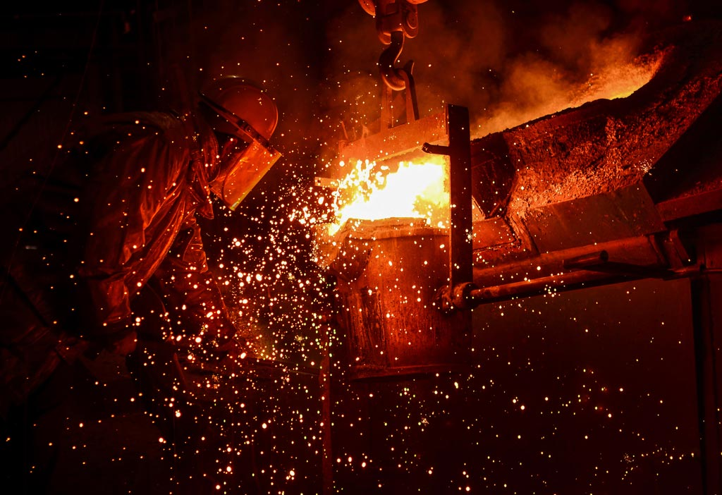PRCO America person working with molten metal that is sparking